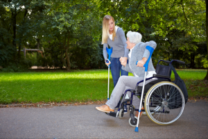 caregiver assisting patient to walk