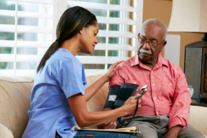 nurse monitoring patient's blood pressure